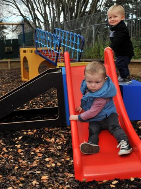 Playing on Brighton Ocean View Playcentre's new equipment  are (from left) Mia Smith (20 months),...