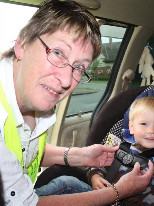 Plunket Otago-Southland car seat services manager Kathryn Impelmans checks 21-month-old Luke...