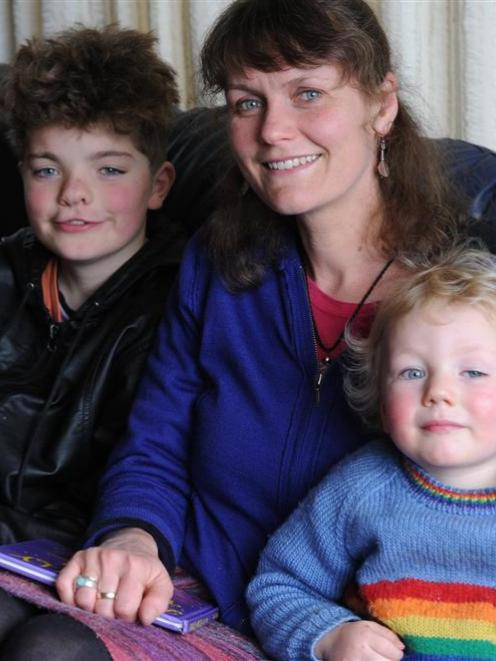 Poet Emma Neale relaxes at home with children Abe (10) and Zac (2). Photo by Craig Baxter.