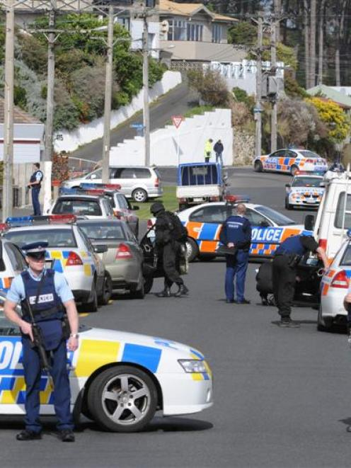 Police and emergency services at a Magdala St house, in Musselburgh, Dunedin, yesterday afternoon...