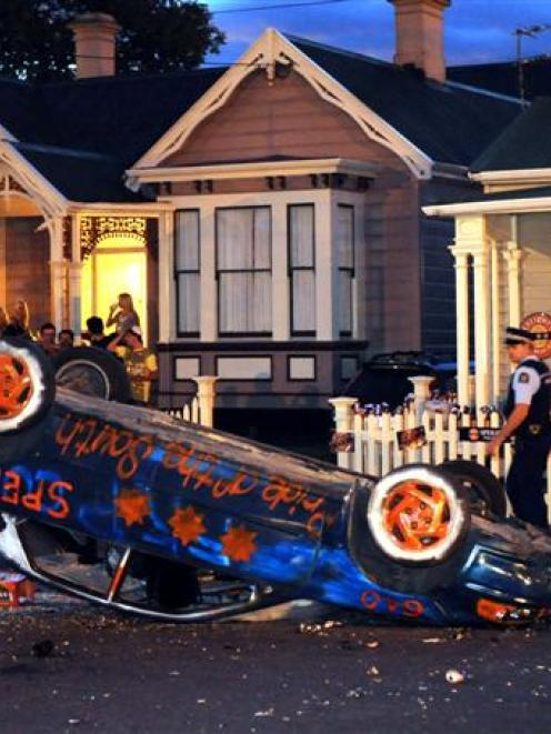 Police and students in Castle St, Dunedin, last night after a decorated vehicle was overturned....