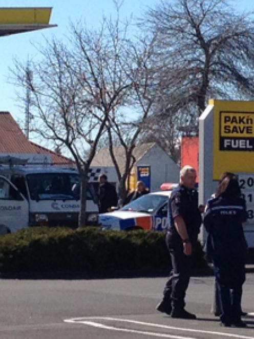 Police at the scene in the supermarket car park. Photo NZ Herald