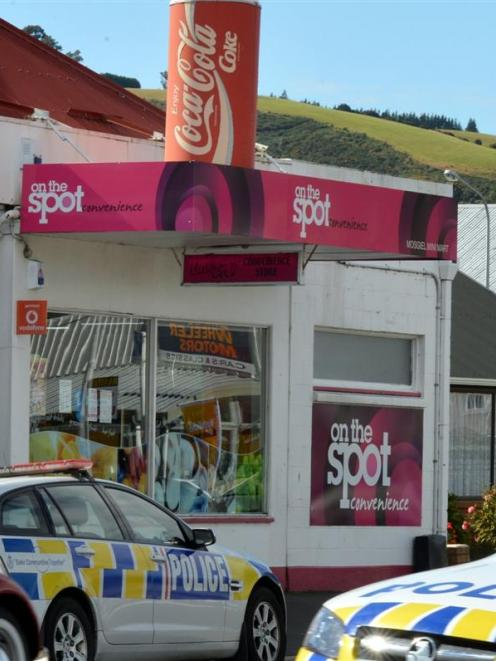 Police at the scene of an armed robbery at a  Gordon Rd, Mosgiel, dairy yesterday morning. Photo...