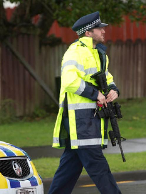 Police at the scene of the Luanda Drive shooting in Ranui where one man was killed and another...