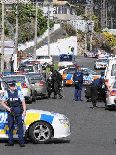 Police block entry to the area near an Armed Offenders Squad callout in the Dunedin suburb of...