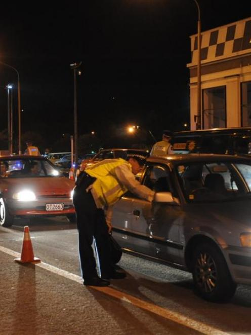 Police check for drink-driving at a roadblock on Cumberland street near the Oval. Photo by...