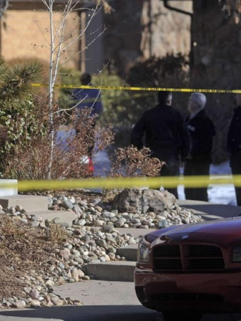Police continue their investigation outside of a home following an overnight hostage-taking...