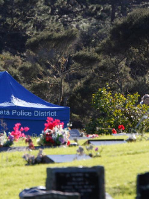 Police continue their search of the cemetery on Eskdale road in Birkdale in relation to the...