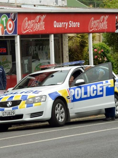 Police cordon off the Quarry Store in Northeast Valley after a female shop assistant was...