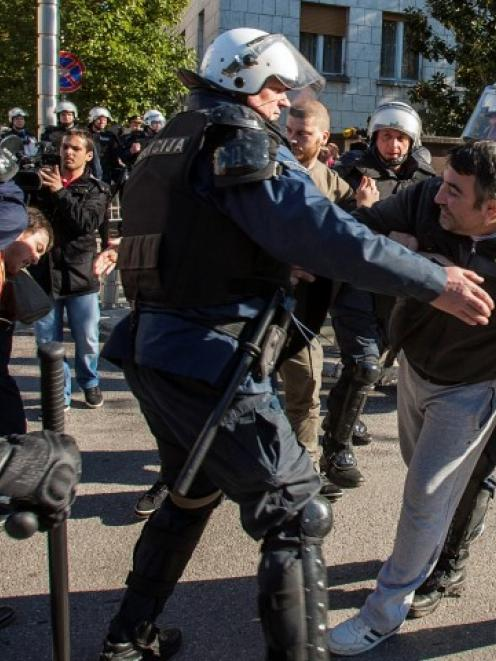 Police detain protesters during a demonstration demanding the resignation of the government in...