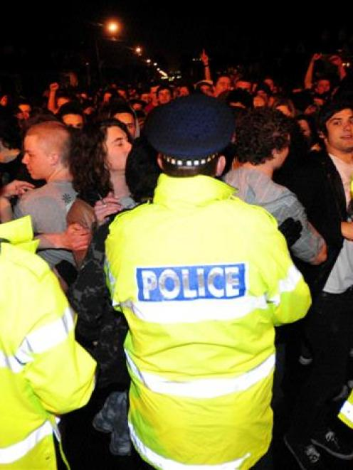 Police face off against the crowd in Castle St. Photo by Craig Baxter