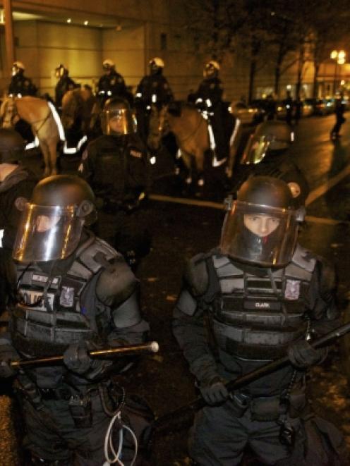 Police in riot gear prepare to move in on Occupy Wall Street protesters in Portland, Oregon....
