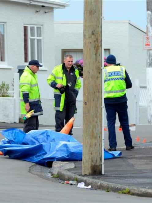 Police inspect the Argyle St and Elgin Rd intersection after a motorcycle crash yesterday. Photo...