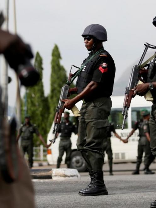 Police officers patrol during a recent protest by the Abuja wing of the 'Bring Back Our Girls'...