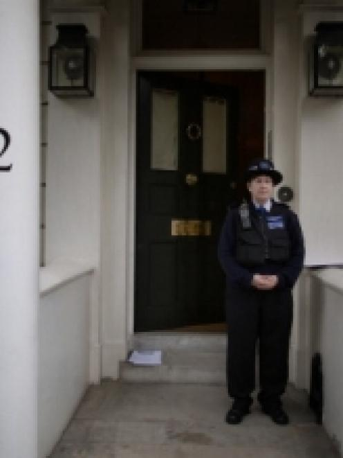 Police tape lines the outside of the house of Eva Rausing in Knightsbridge, London. (Photo by...