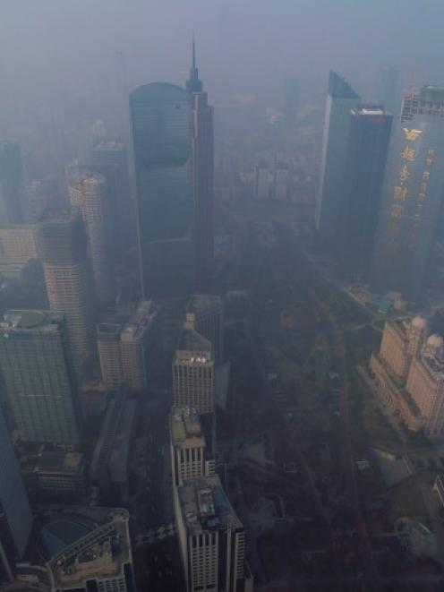 Pollution creates a thick haze in the central business district in Guangzhou, Guangdong province....