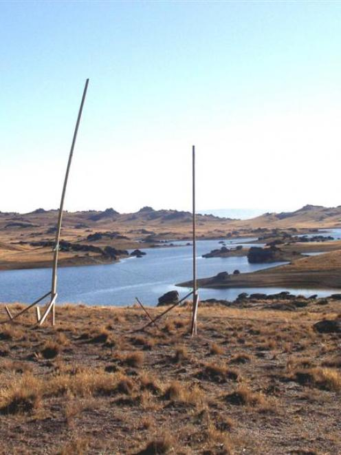 Poolburn Dam with poles showing the profile of one of two houses proposed to be built on the...