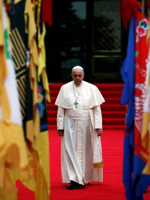 Pope Francis arrives to attend a welcoming ceremony at the presidential Blue House in Seoul....