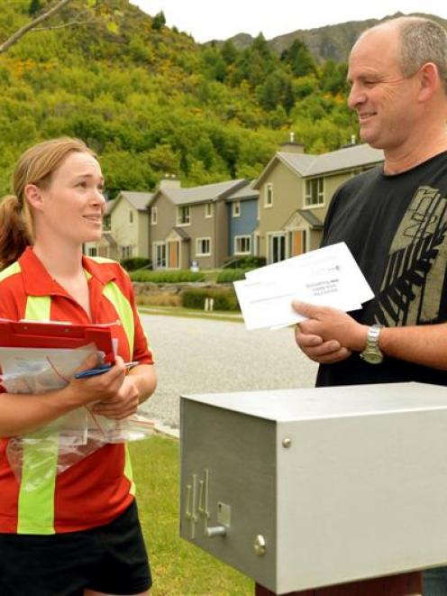 Postie Terri Oakden delivers a letter to Peter Crum, of Arrowtown, yesterday. Photo by Stephen...