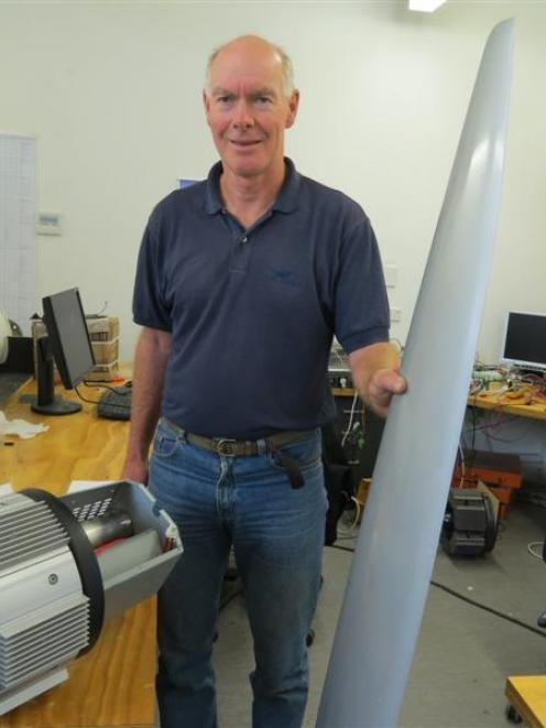 Powerhouse Wind director Bill Currie shows off parts of his Thinair one-bladed windmill which is...