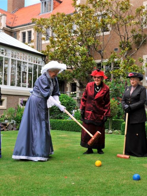 Practising croquet yesterday  for this weekend's Olveston Edwardian garden party are (from left)...