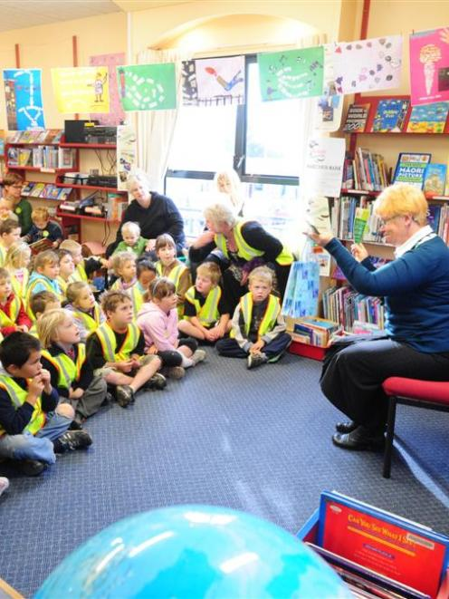 Presbyterian Support Otago chief executive Gillian Bremner reads to preschoolers during the...