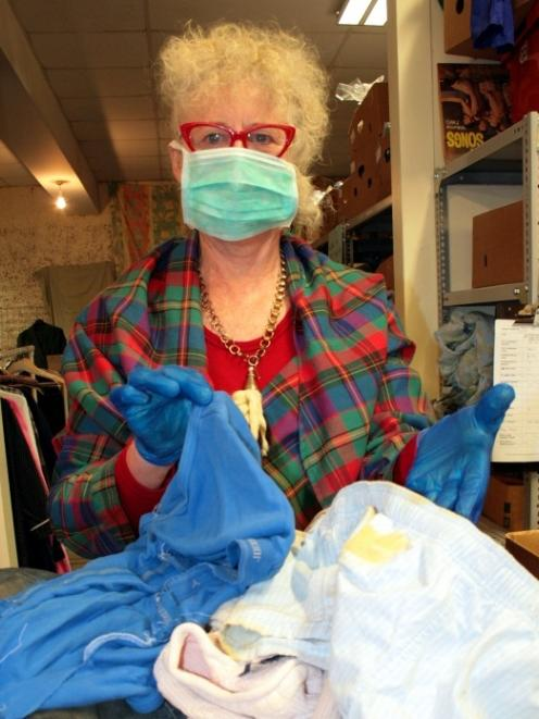 Presbyterian Support retail manager Chrissy Anderson holds up some of the dirty items that have...