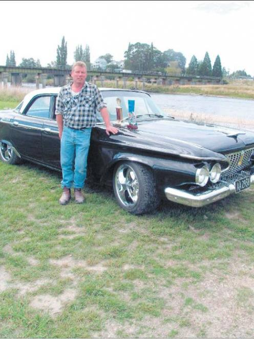 Pride and joy: Michael Hood stands beside his late father ' s 1961 P lymouth B elvedere , which...