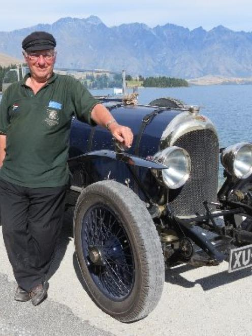Pride and joy . . . Bentley Drivers' Club member Roy Partridge, of England, stands beside his...