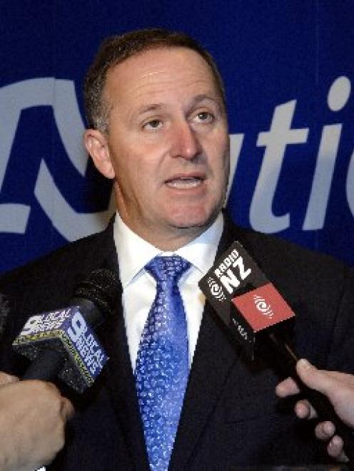 Prime Minister John Key fields questions from media after the National Party Mainland Region...