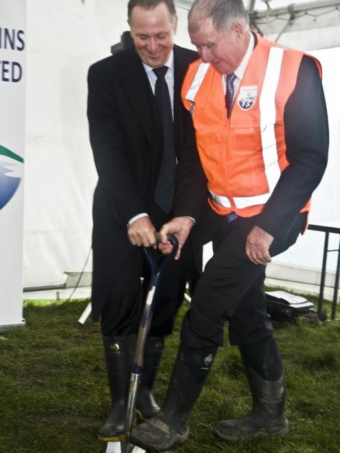 Prime Minister John Key (left) and Central Plains Water Ltd chairman Doug Catherwood turn the...