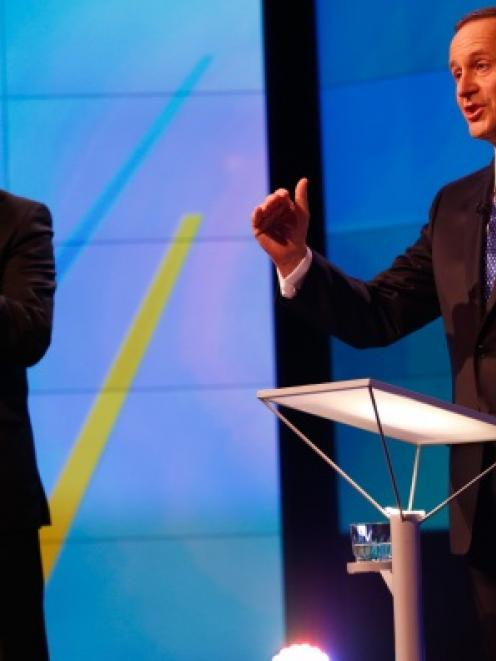 Prime Minister John Key (right) and Labour Leader David Cunliffe go head to head at the TVNZ...