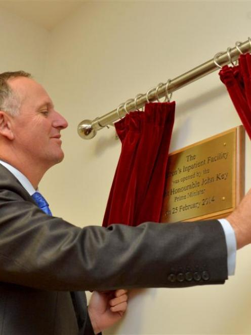 Prime Minister John Key unveils a plaque at the opening of the Dunedin Hospital's Children's...