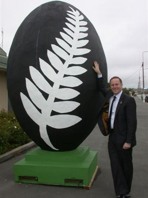 Prime Minister John Key yesterday planned to send his photo with this giant rugby ball in Oamaru...