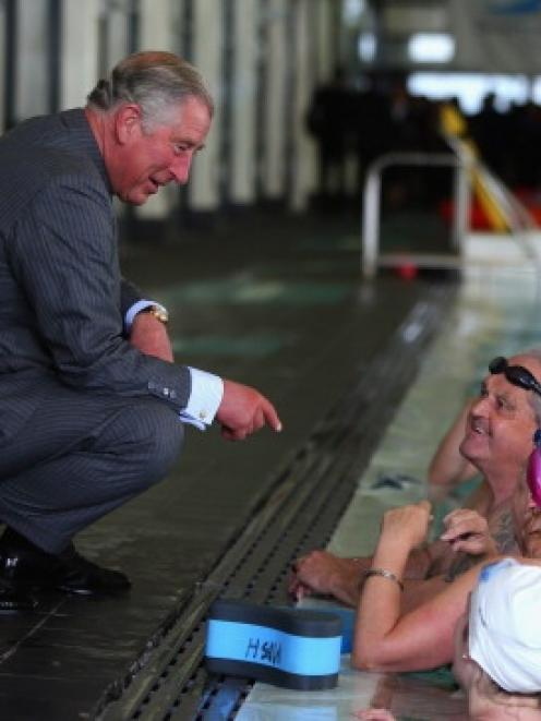 Prince Charles chats with swimmers at the Millenium Sports Institute. (Photo by Phil Walter/Getty...