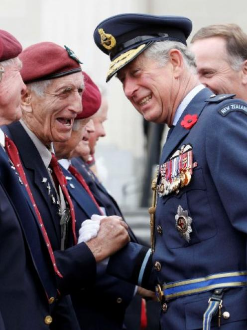Prince Charles greets a returned soldier as he attends the Armistice Day Commemoration at the...