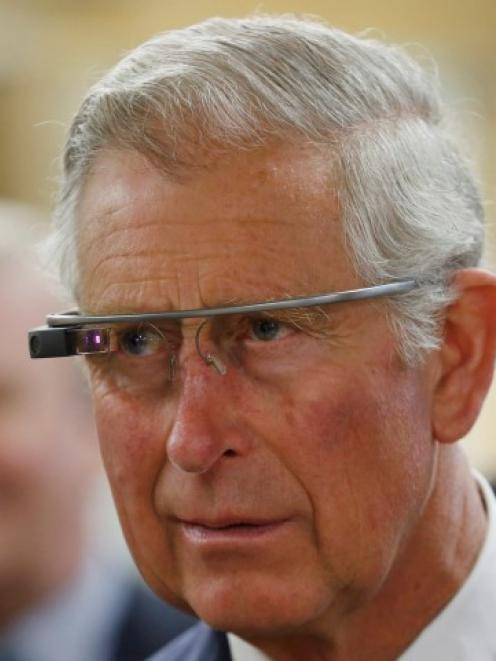 Prince Charles tries a pair of Google glasses to use software developed at an innovation centre...
