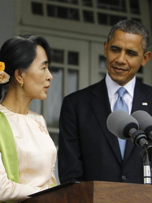 Pro-democracy leader Aung San Suu Kyi with US President Barack Obama at her home in Yangon....