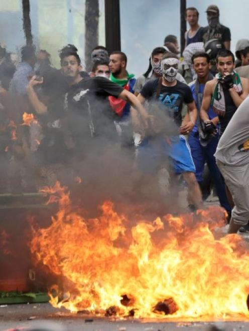 Pro-Palestinian protesters face police in Paris during a demonstration against violence in the...