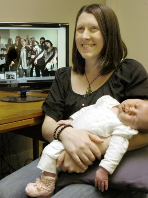 Producer Zoe Hobson and her 4-week-old daughter, Abigail, in Dunedin yesterday. Abigail will have...