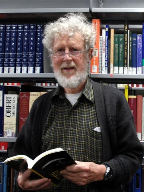 Prof Jim Flynn with a copy of his book in the University of Otago central library. Photo by...