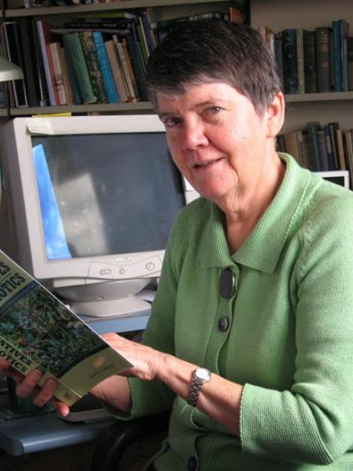 Prof Judith Bennett, of the University of Otago history department, examines a copy of her latest...