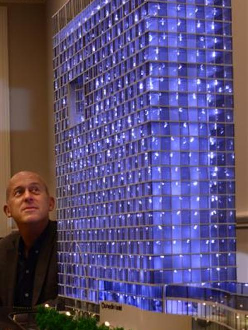 Project spokesman Steve Rodgers examines a scale model of a proposed new hotel for Dunedin, which...