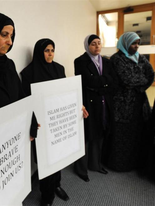 Protesters and onlookers outside a meeting organised for Islam Awareness Week at the University...