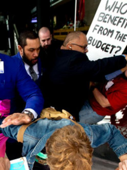 Protesters and SkyCity security clash as they try to storm a lunch at SkyCity hosted by Prime...