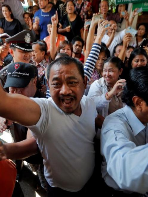 Protesters demanding the right to vote argue with officials at a Din Dang district office where...