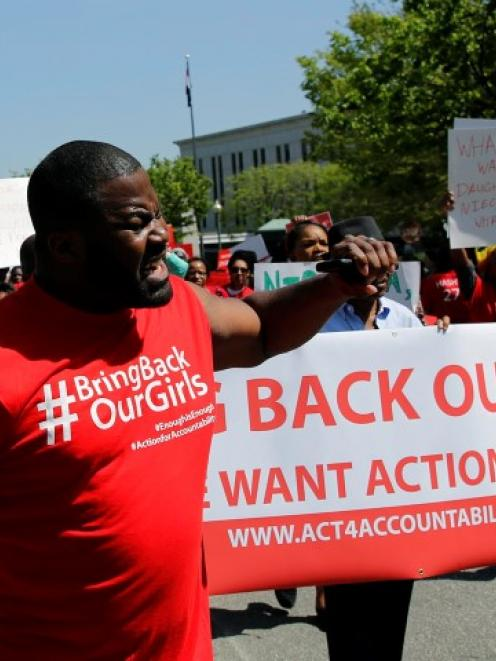 Protesters march in in front of the Nigerian Embassy in Washington in support of the girls...