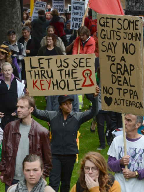 Protesters march on Dunedin's Octagon as part of nationwide action against the Trans-Pacific...