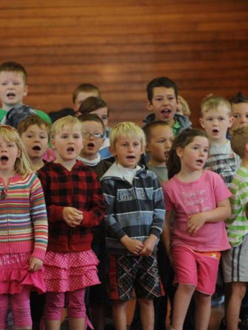 Pupils perform at a concert marking the opening of their new school. Photo by Peter McIntosh.