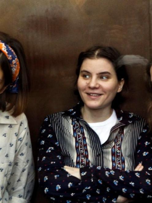 Pussy riot members (L-R) Nadezhda Tolokonnikova, Yekaterina Samutsevich, and Maria Alyokhina...